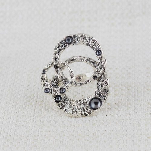Moon Ring Composition Earrings with burnishings in craters 1